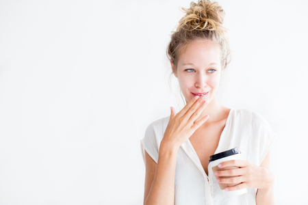 embarrassment: Embarrassed Young Lovely Woman Holding Drink
