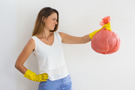 pinched: Frowning young woman hating cleaning