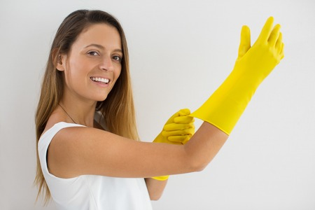 Smiling beautiful woman preparing for cleaning Stock Photo