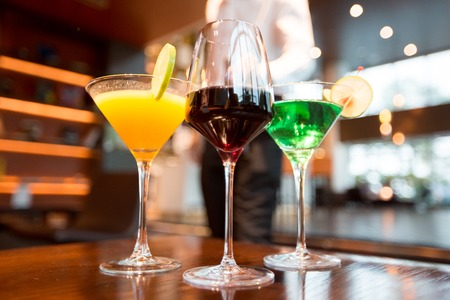 Three Glasses of Different Alcoholic Drinks in Bar Stock Photo