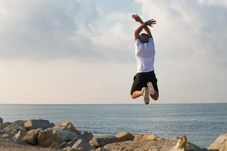 Free bald man jumping and waving hands Stock Photo
