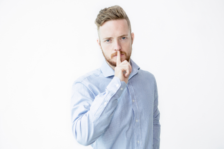 Serious Handsome Man Making Silence Gesture