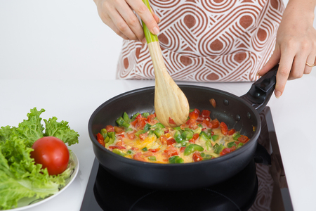 Close-up of woman cooking healthy breakfast Stock Photo