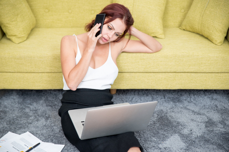 work life balance: Confident businesswoman talking on phone at home Stock Photo
