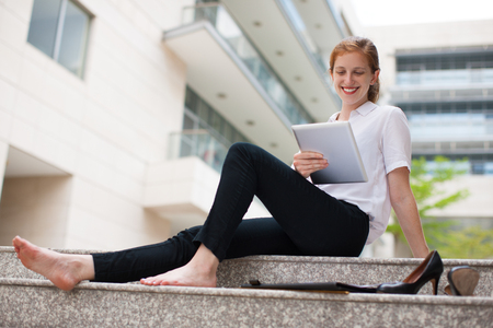 work life balance: Cheerful businesswoman or student using touchpad