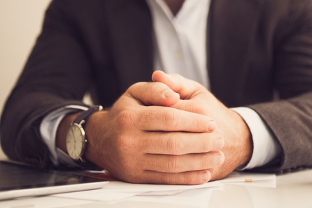 Businessman with hands on table Stock Photo