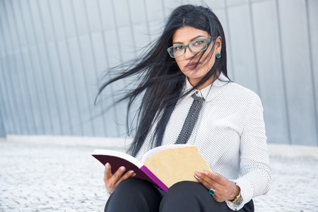 confident smart woman reading business book stock photo picture and