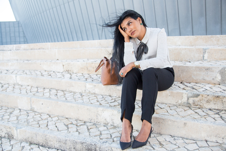 tired: Pensive tired businesswoman waiting for colleague