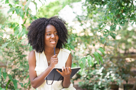 african business: Smiling Attractive Black Woman Working in Park