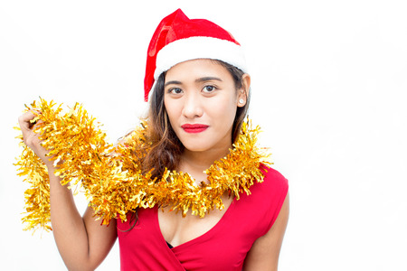 Confident woman showing Christmas garland on neck