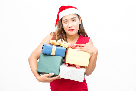 Happy woman in Santa hat holding heap of boxes