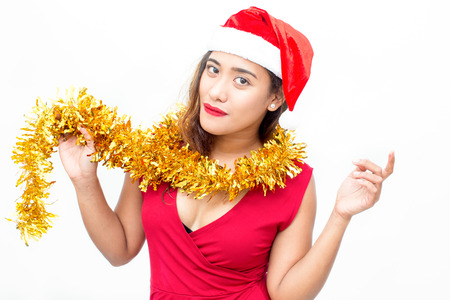 Happy woman posing with Christmas garland and hat