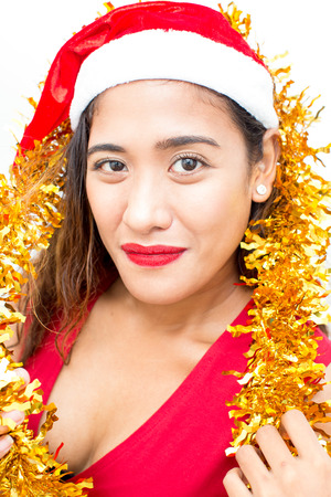 Close-up of smiling mid adult woman in Santa hat