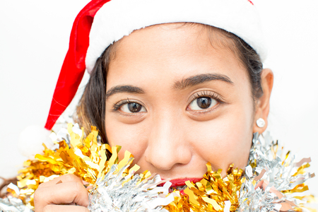 Smiling face of young Asian woman with garland Stock Photo