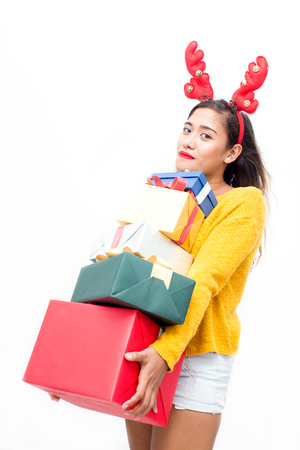 Cool girl carrying stack of Christmas presents