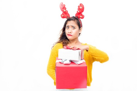 Misunderstanding pretty woman holding gift boxes