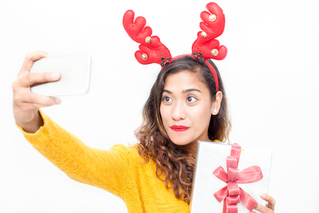 Smiling woman posing for selfie with gift Stock Photo