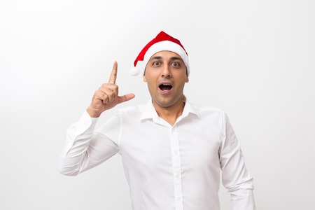 pay raise: Man Wearing Santa Claus Hat and Raising Finger Up Stock Photo