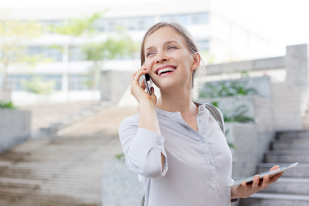 Happy young lady talking on phone