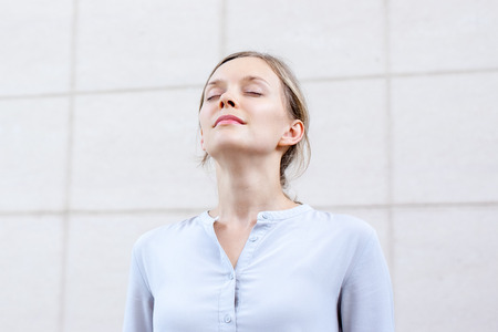 Relaxed young woman feeling spiritual energy Banque d'images