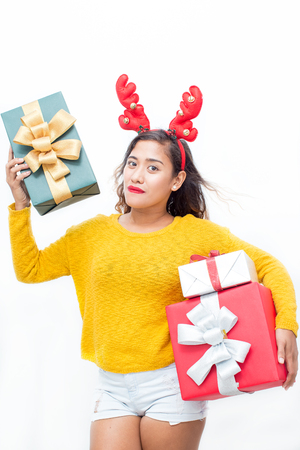 Lady Wearing Reindeer Horns and Holding Gift Boxes