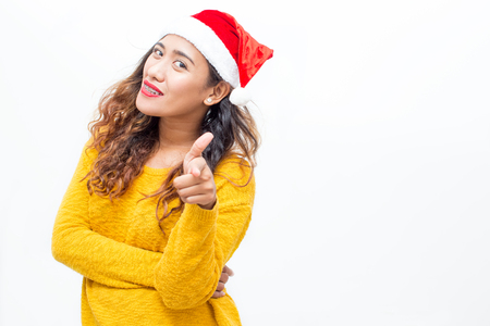 Smiling Woman in Santa Hat Pointing at You