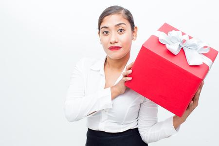 vietnamese ethnicity: Confident businesswoman showing big gift box Stock Photo