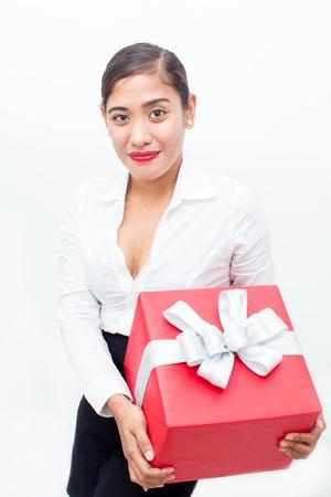 vietnamese ethnicity: Portrait of smiling businesswoman holding gift box
