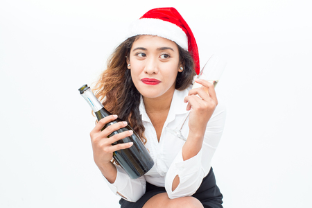 vietnamese ethnicity: Serious businesswoman sitting with champagne