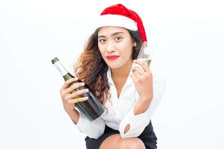 professional flute: Smiling businesswoman in Santa hat with bottle