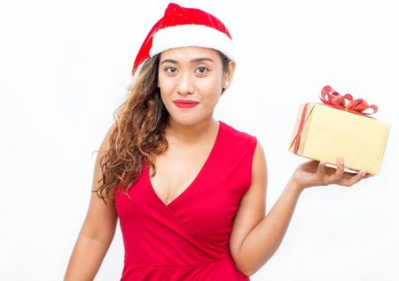 vietnamese ethnicity: Smiling woman in Santa hat holding gift box
