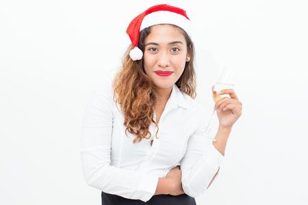 professional flute: Happy businesswoman in Santa hat holding flute