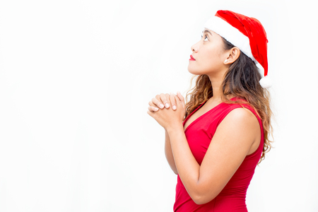 religious clothing: Calm woman in Santa hat pleading and looking up