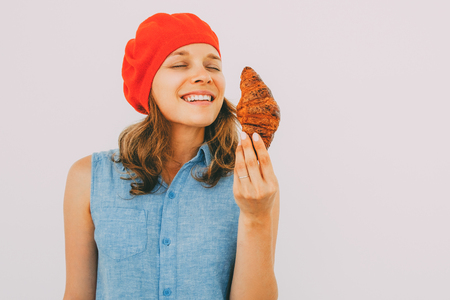 Smiling Pretty Woman Smelling Delicious Croissant