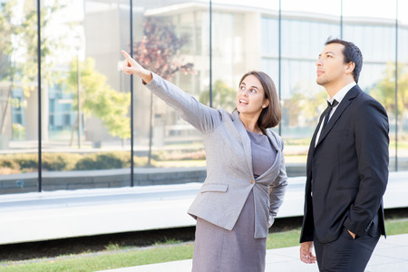 Content Business People Standing Outdoors Stock Photo