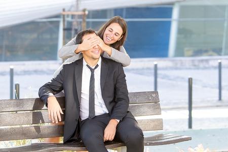 Joyful Business Woman Covering Colleague Eyes