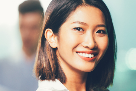 Closeup of Smiling Pretty Young Asian Woman Stock Photo