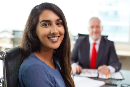 Face of smiling businesswoman sitting in office