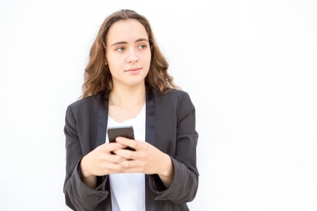 Concentrated female manager thinking of message