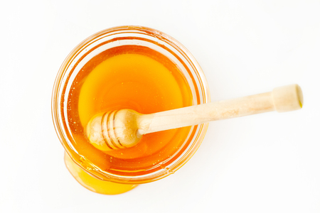 Dipper in Bowl with Honey and Splash