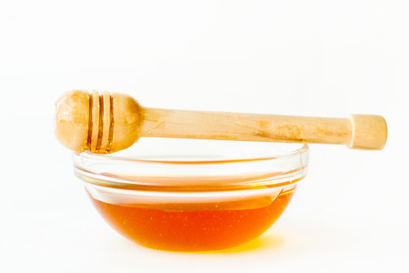 drizzler: Wooden Drizzler on Bowl with Honey