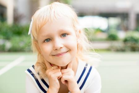 Closeup of Pretty Fair-haired Little Girl Outdoors