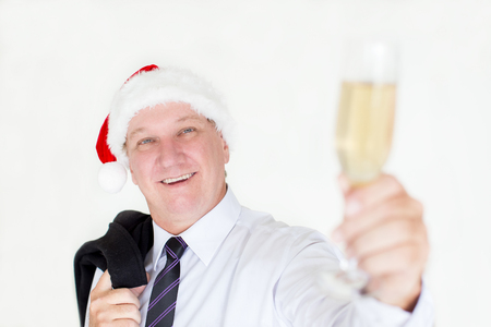 Cheerful dreamy man having fun at office party Stock Photo