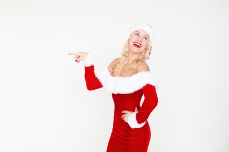 Joyful Lady in Christmas Costume Pointing Aside Stock Photo