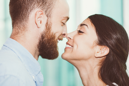 Portrait of lovely young couple rubbing noses