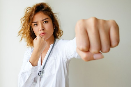 Portrait of angry general practitioner boxing 版權商用圖片