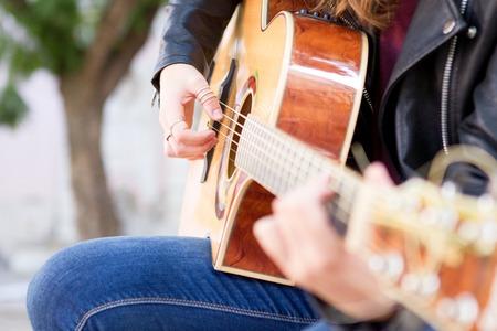 Closeup of Street Musician Playing Guitar