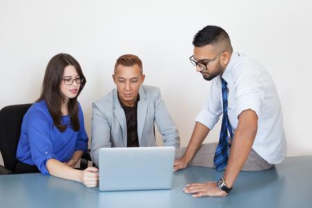 Serious executives connecting partner via laptop
