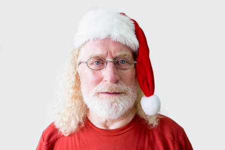 Portrait of Friendly Senior Man in Christmas Hat