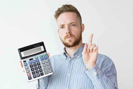 Portrait of Serious Young Clerk with Calculator